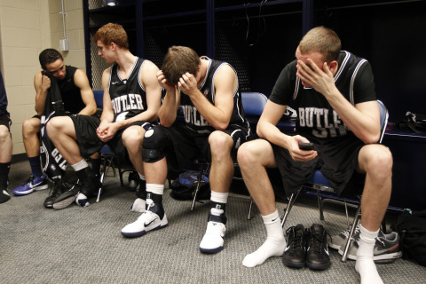 Members of the Butler Bulldogs express their dejection after losing the men's final NCAA Final Four college basketball championship game to the University of Connecticutin Houston, Texas